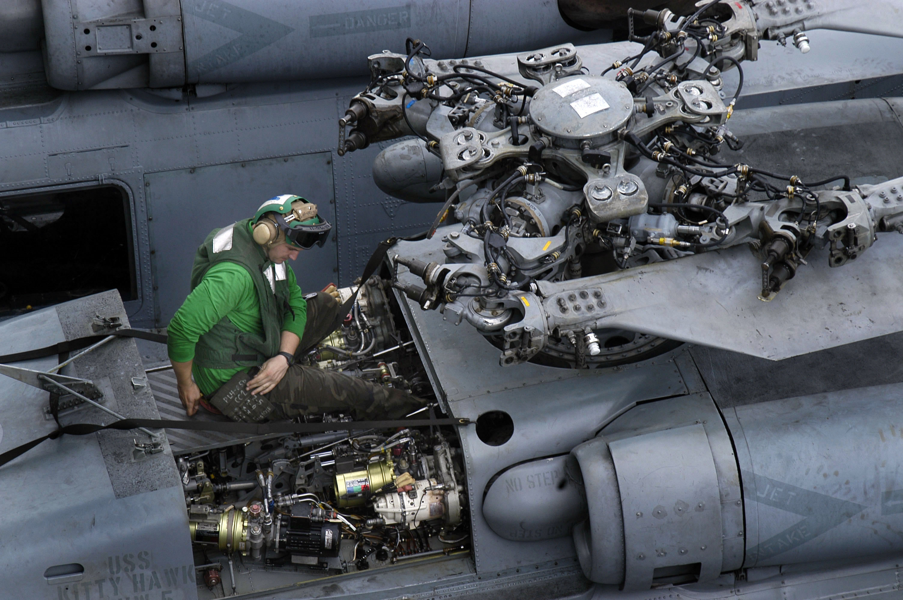 US_Navy_050525-N-0167B-011_An_Aviation_Electronics_Technician_performs_corrosion_control_on_an_HH-60H_Seahawk_helicopter.jpg