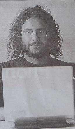 Photo of Alaa Using His Laptop