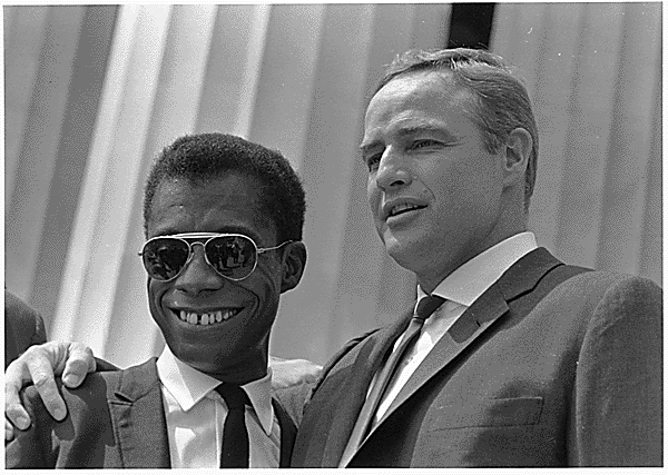 James Baldwin with Marlon Brando on a civil rights march in 1963
