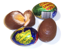 Cadbury eggs, a common Easter candy. One is br...