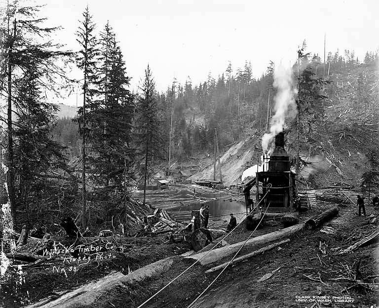 File donkey engine beside log holding pond with logging for Pond companies near me