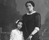 Hannah with her mother, age 6
