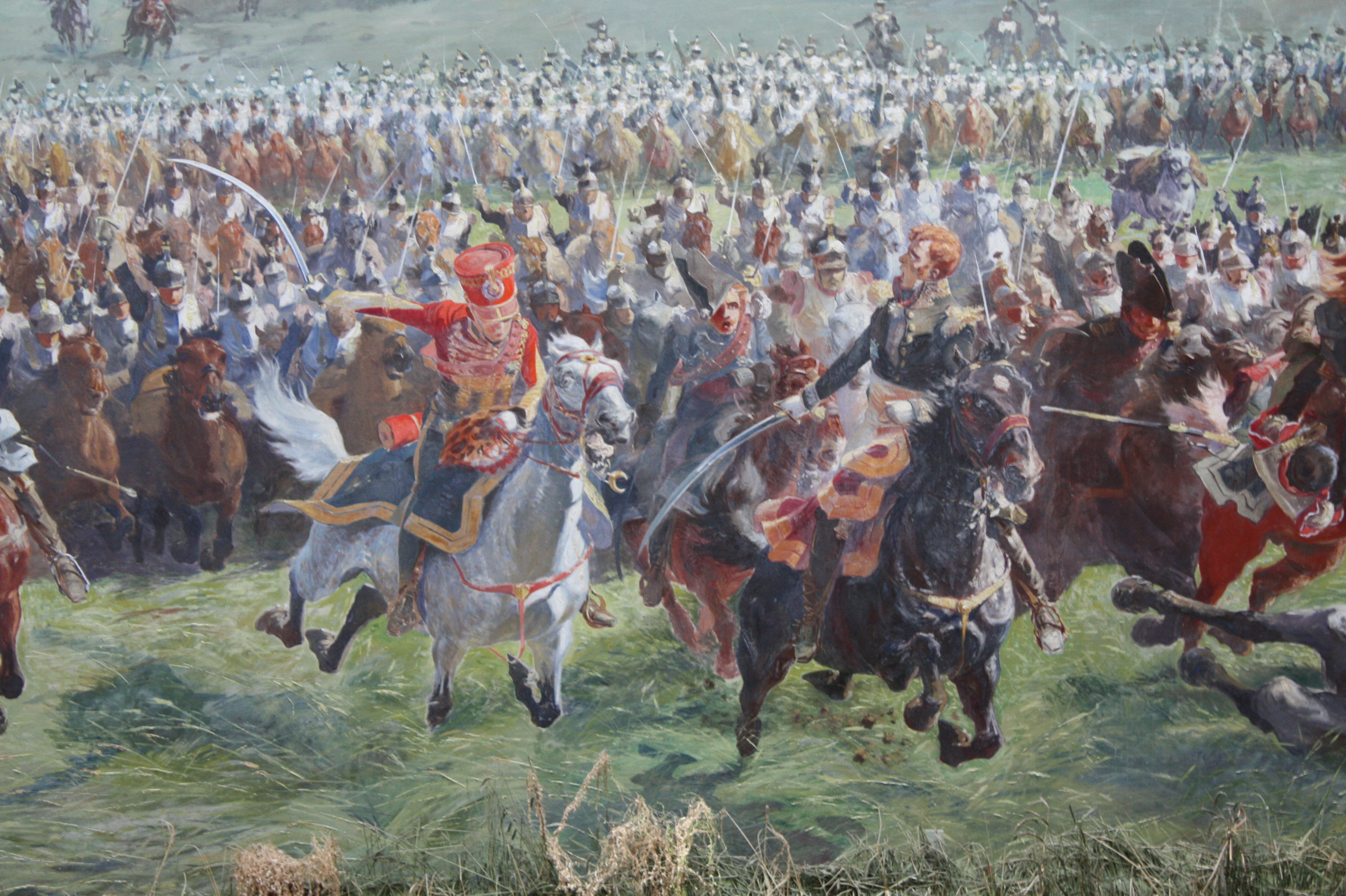 """Marshall Ney and his staff leading the cavalry charge at Waterloo,"" by Louis Dumoulin (1860-1924). Public domain, via Wikimedia Commons."