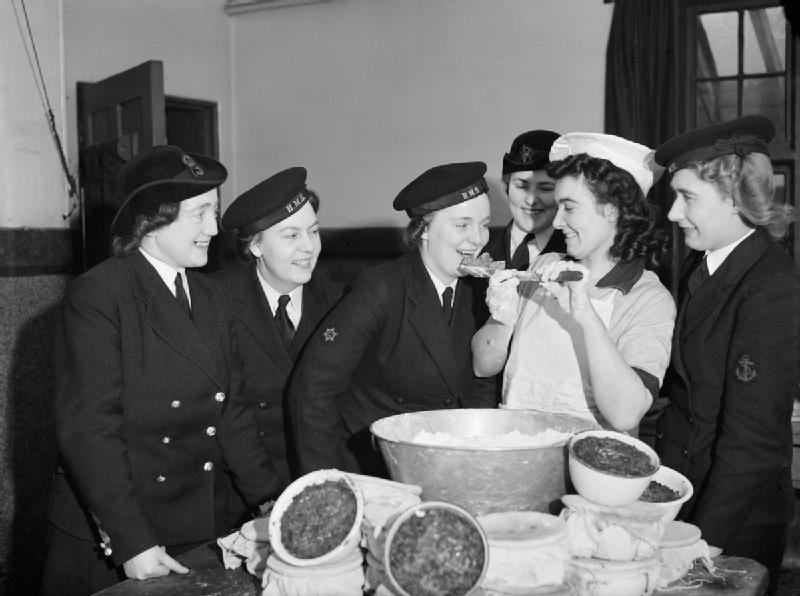 Members of the Women's Royal Naval Service sampling the Christmas pudding at Greenock in Scotland, 19 December 1942. A13392