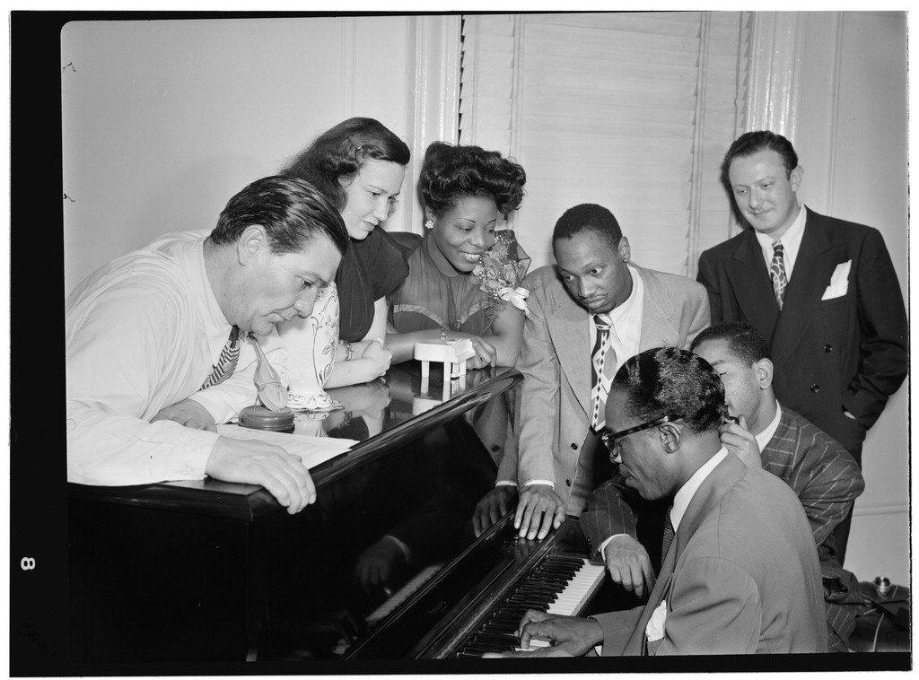 Mary Lou Williams in her apartment with Jack Teagarden, Tadd Dameron, Hank Jones and Dizzy Gillespie