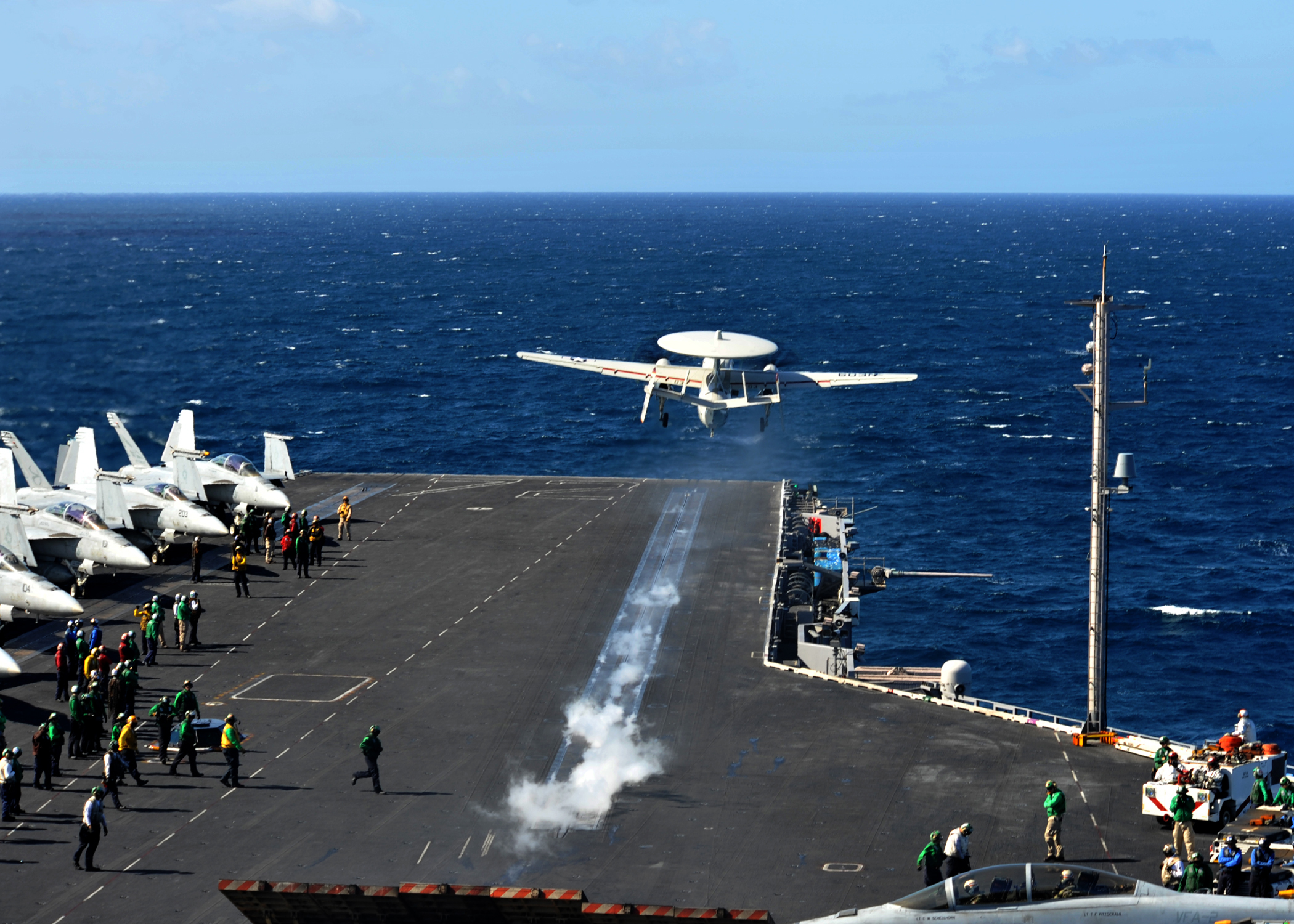 from the flight deck of the Nimitz-class aircraft carrier USS Abraham Lincoln (CVN 72). Abraham Lincoln is underway conducting a composite training unit