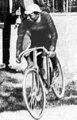 A man with a hat on a bicycle.