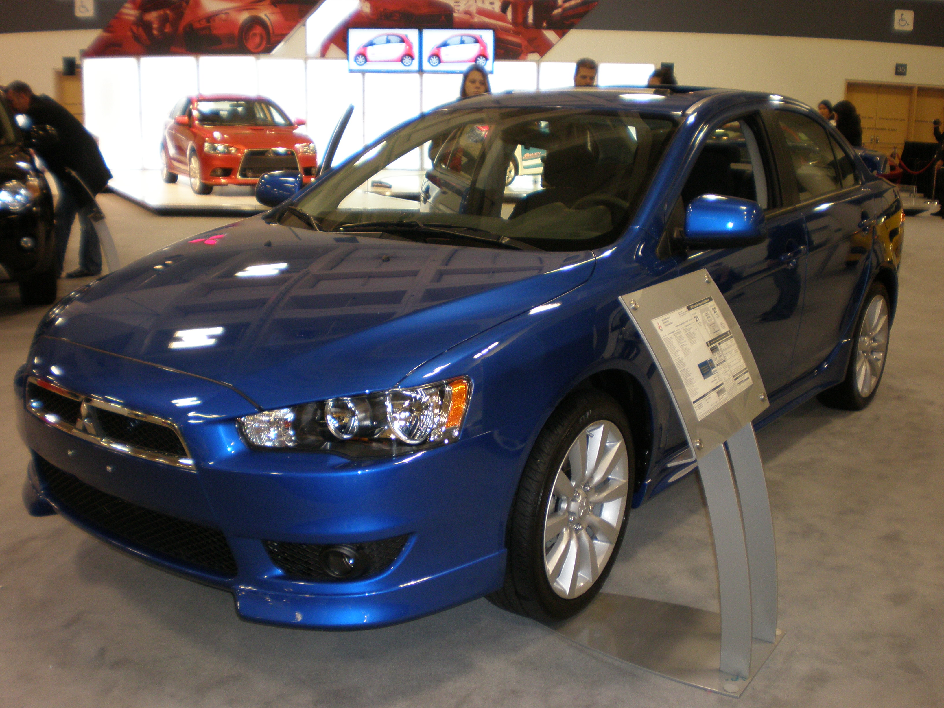 File:2009 blue Mitsubishi Lancer GTS 2.4L front side.JPG - Wikimedia Commons