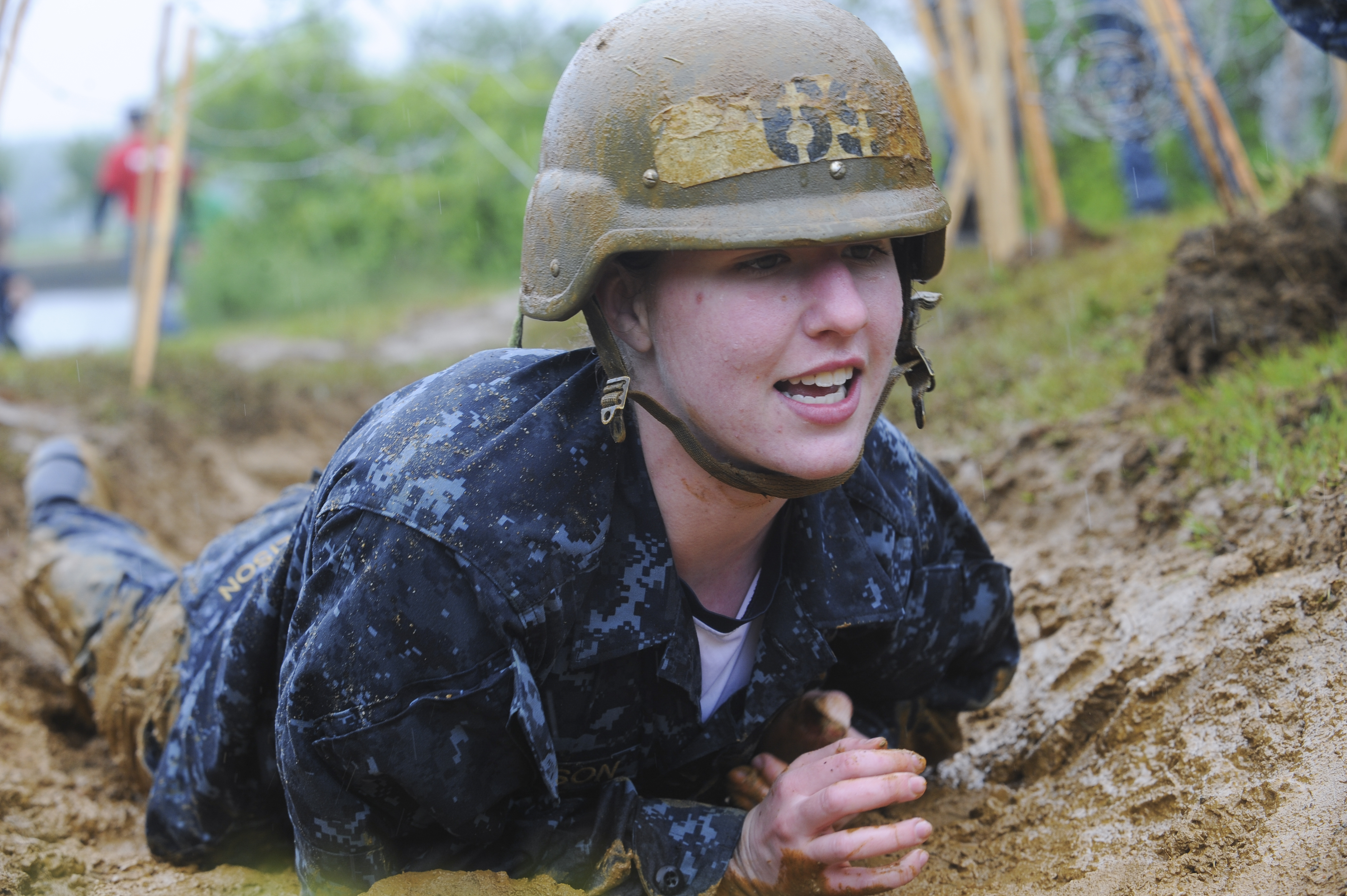File:A plebe crawls through a trench during the class of