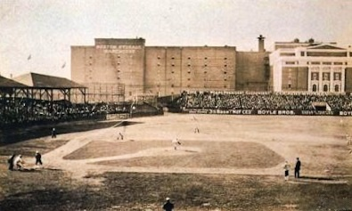 "The Huntington Avenue Grounds during a game. Note building from which the famous 1903 ""bird's-eye"" photo was taken. Huntington Avenue Grounds.jpg"