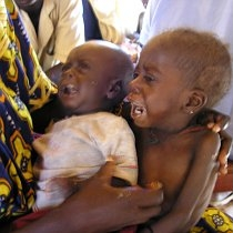 Laure Souley holds her three-year-old daughter and an infant son at a MSF aide center during the 2005 famine, Maradi Niger