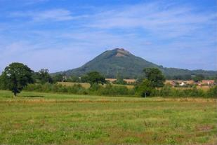 The Wrekin is a prominent geographical feature located in the east of the county. Rhekin by Wrodian.jpg