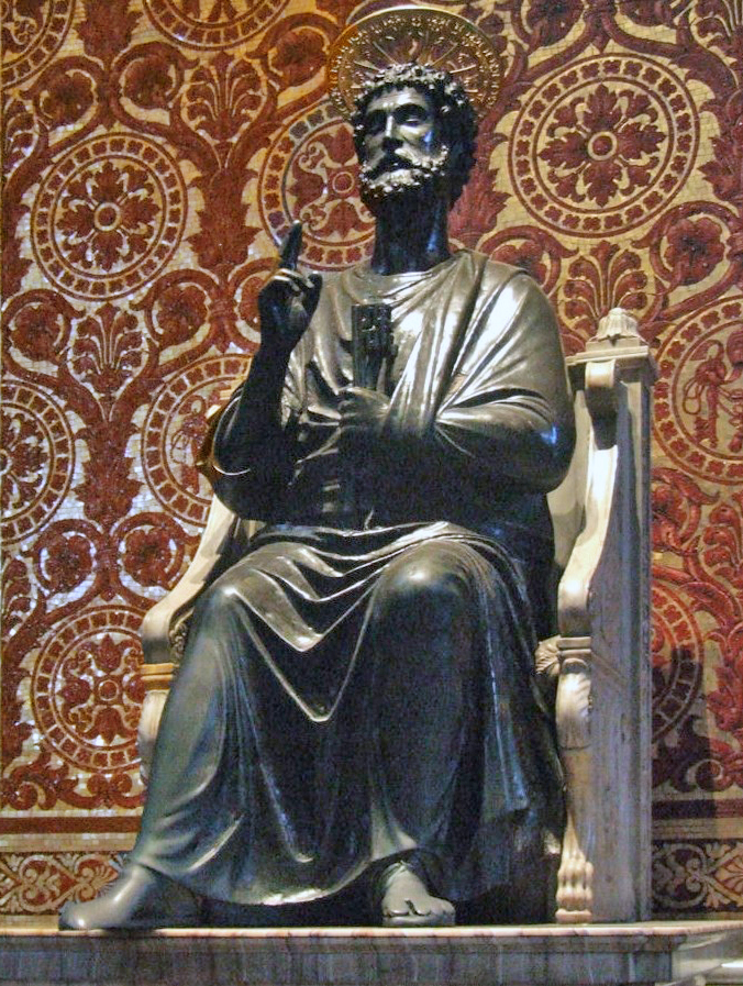 Peter is shown as a bearded man in draped garment like a toga. He is seated on a chair made of marble, and has his right hand raised in a gesture of blessing while in his left hand he holds two large keys. Behind the statue, the wall is patterned in mosaic to resemble red and gold brocade cloth.