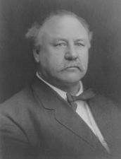 Governor Ralston, a mustached middle aged man