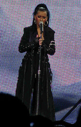 Aguilera performing during The Stripped Tour in 2003
