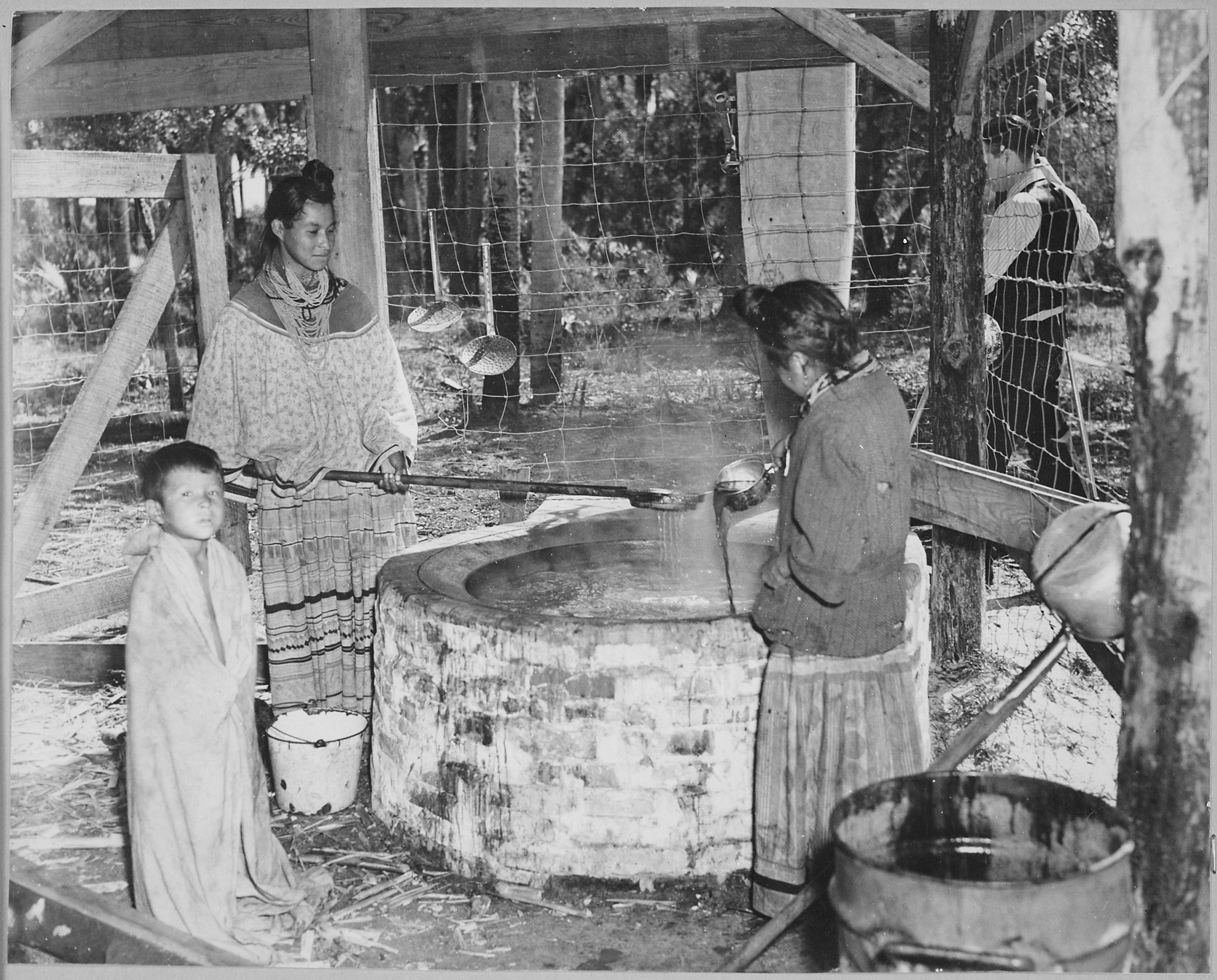 File two seminole women cooking cane syrup seminole for Native agency