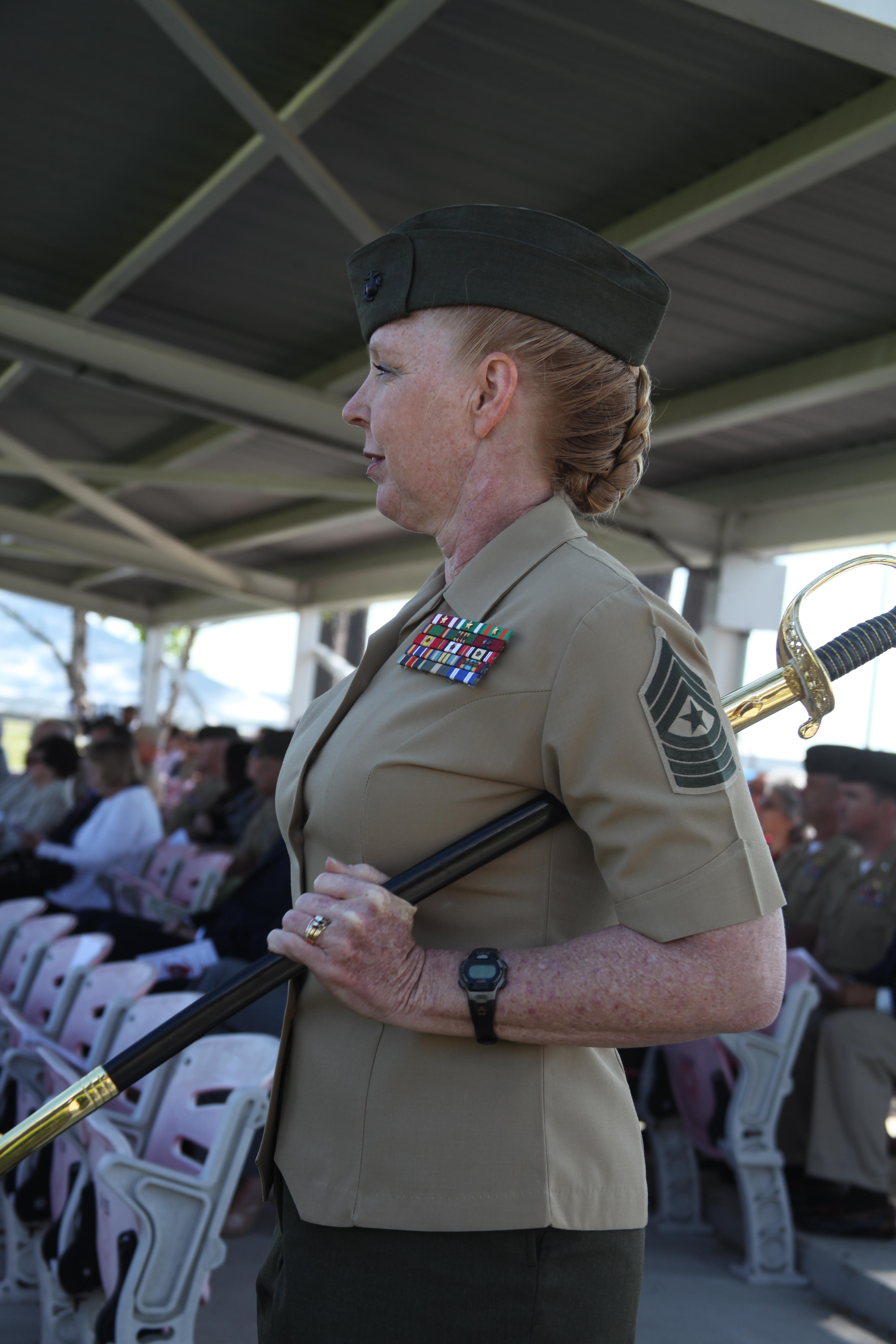 File:U.S. Marine Corps Sgt. Maj. Holly C. Prafke cradles a ...
