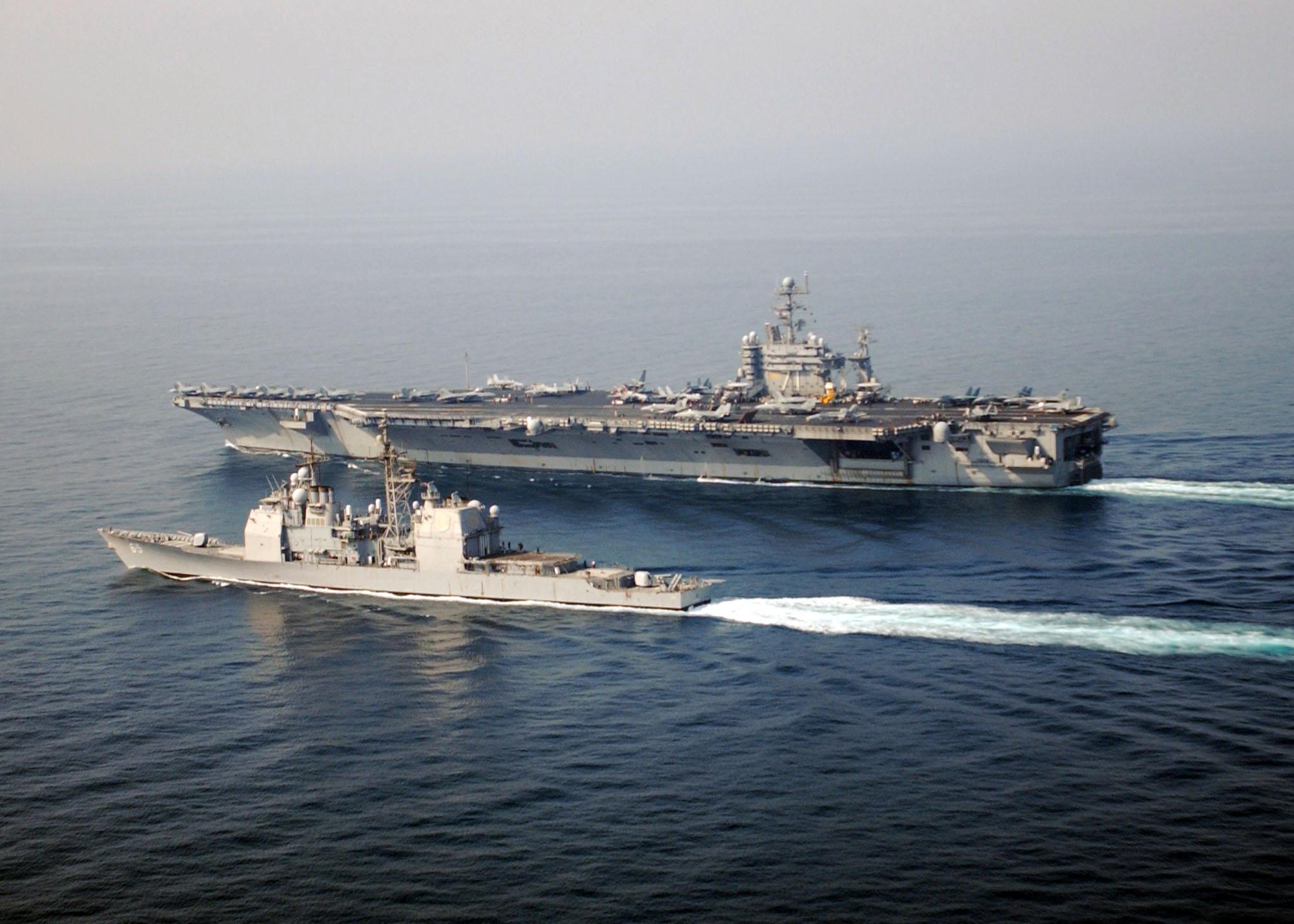 USS Chosin (CG 65) alongside USS Theodore Roosevelt (CVN 71)