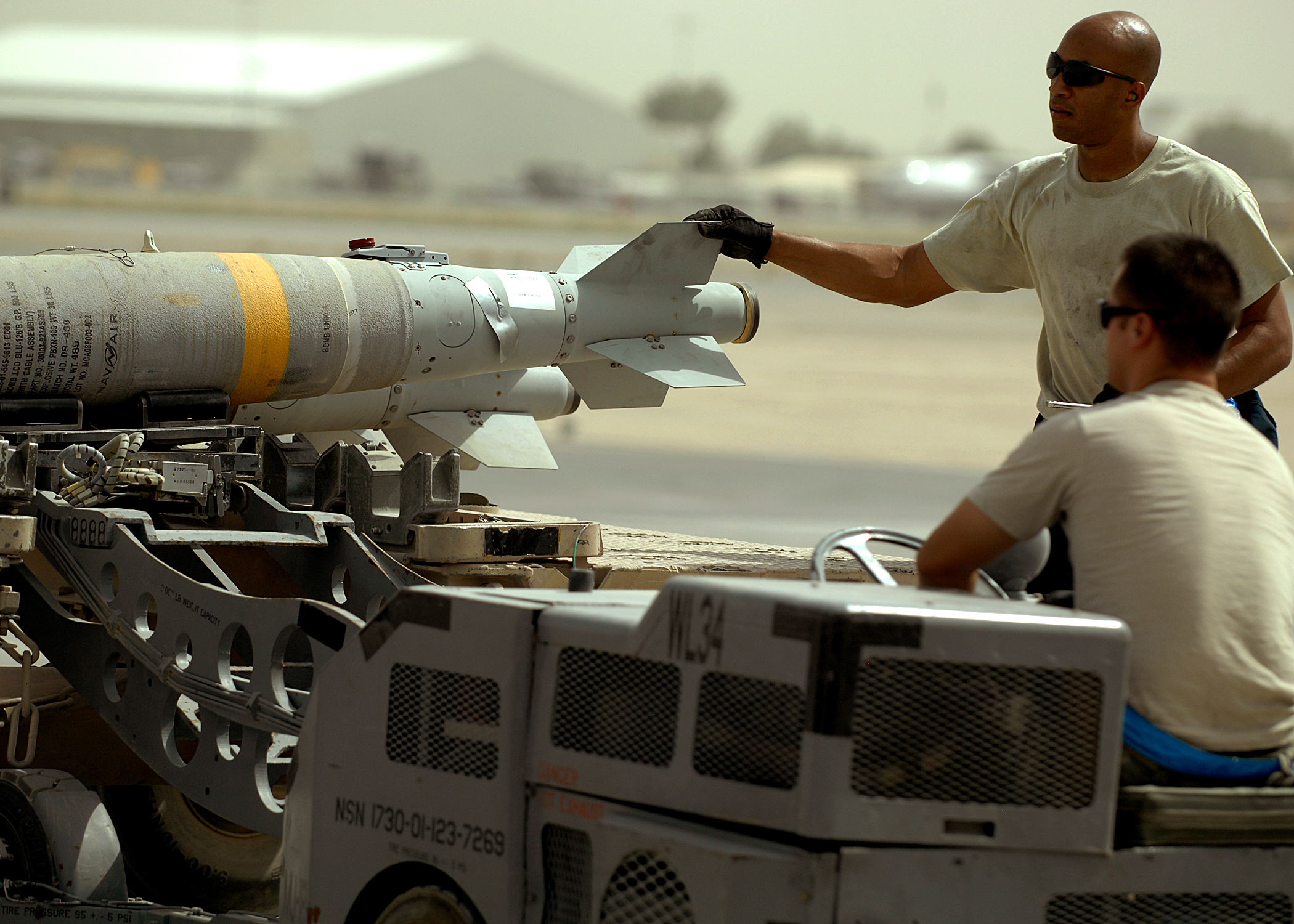 File:Airmen deployed to Afghanistan load ammo onto A-10's