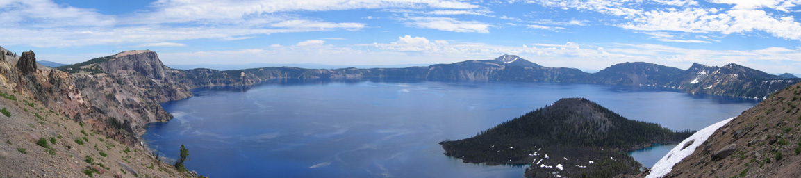 ✮ Twilight falls over Oregon's Crater Lake - Panoramic view of Crater Lake, with a portion of the original mountain's surface profile seen at left