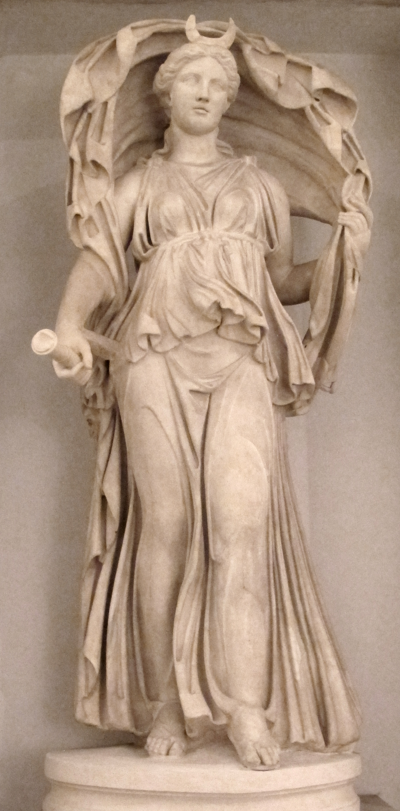 Statue Of Selene Shown Wearing The Crescent On Her Forehead And Holding A Torch In Right Hand While Veil Billows Over Head