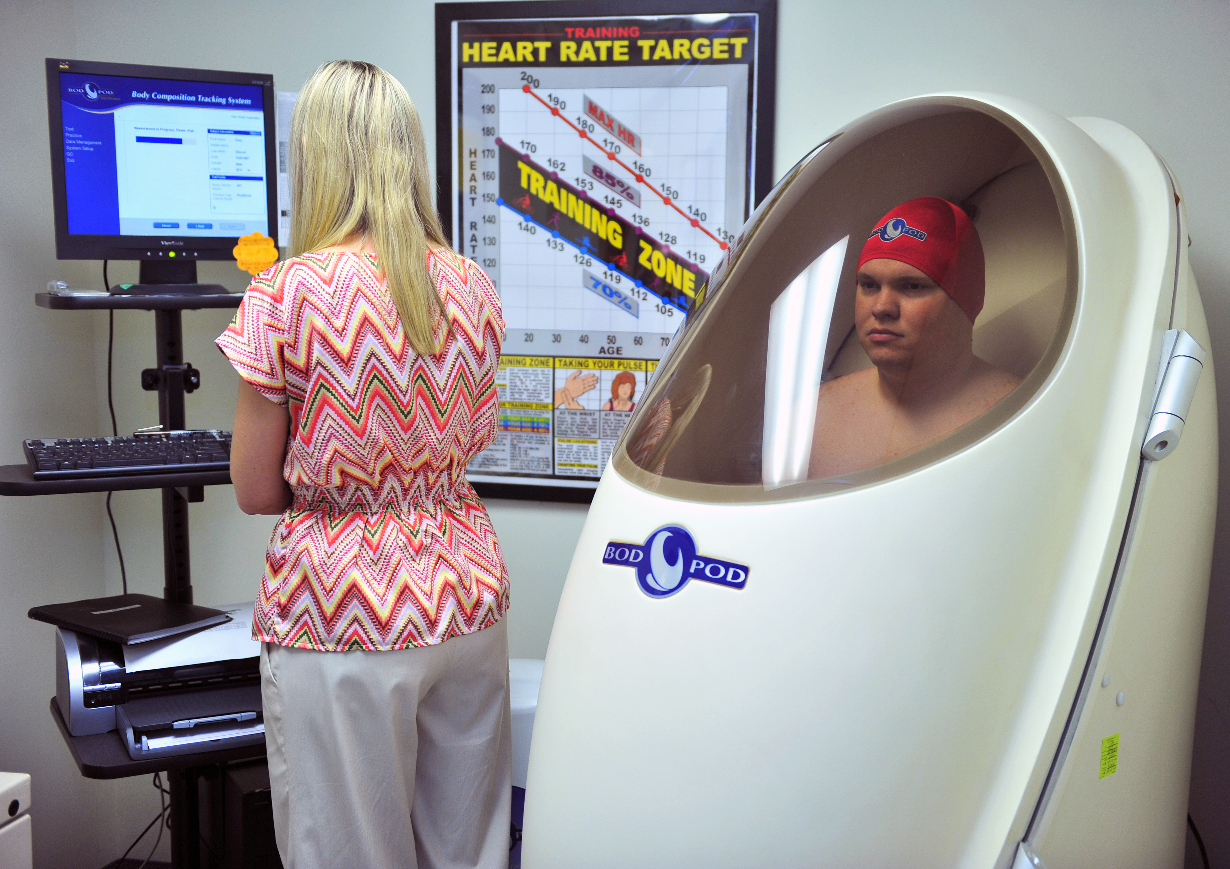 U S Air Force Staff Sgt Cory Simcoe C Aerospace Ground Equipment Journeyman With The Th Equipment Maintenance Squadron C Sits In A Bod Pod While Penny Hardin C Health Promotion Flight Chief With The Th F Da on Health Promotion