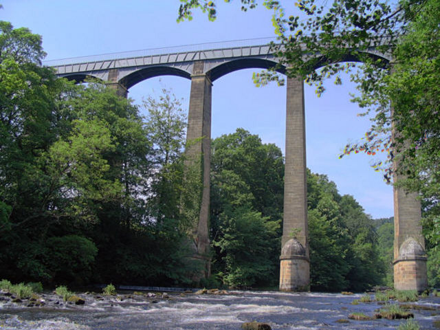 The view from the bottom of the bridge, pillars towering above.