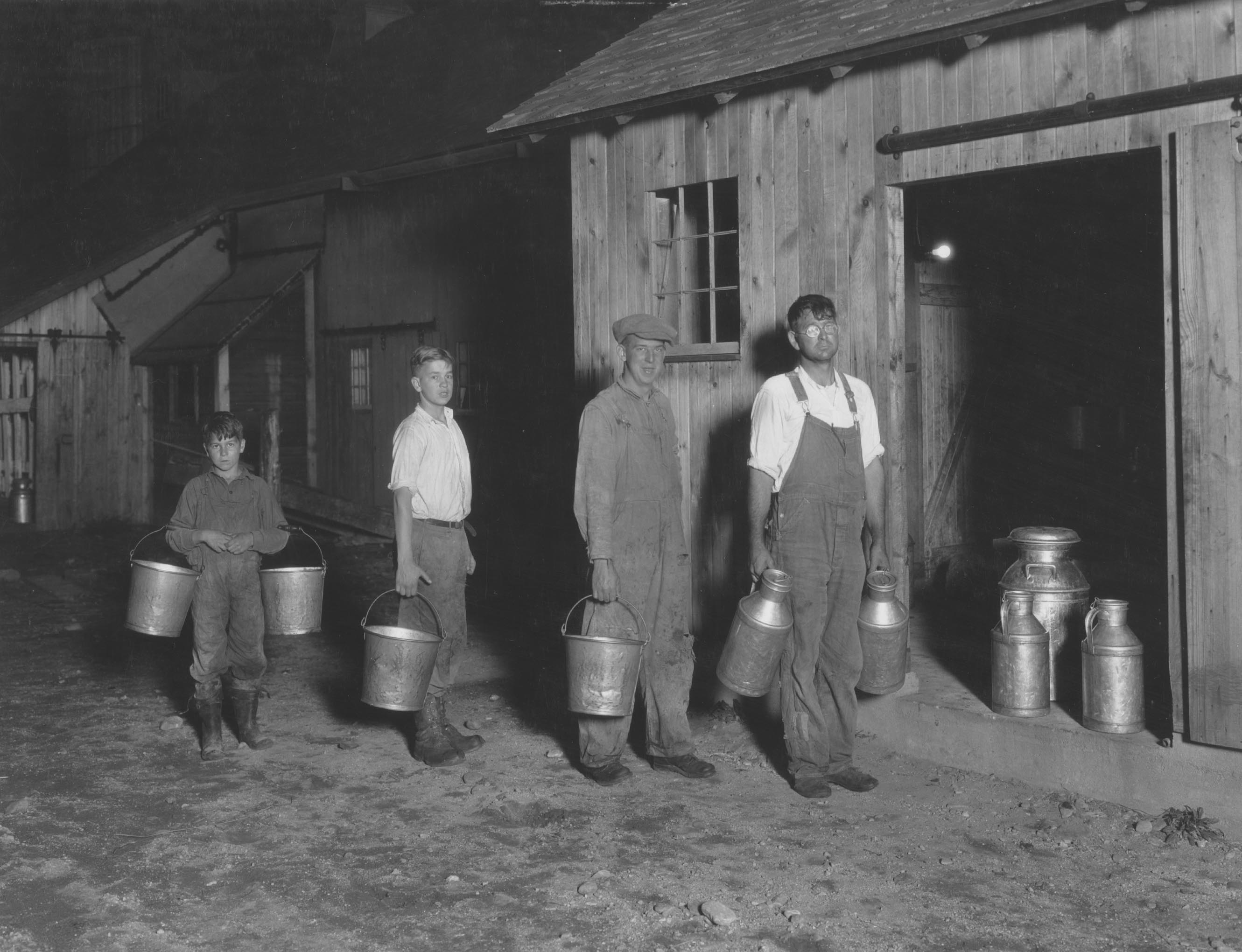 A New London County family readies for milking in 1928