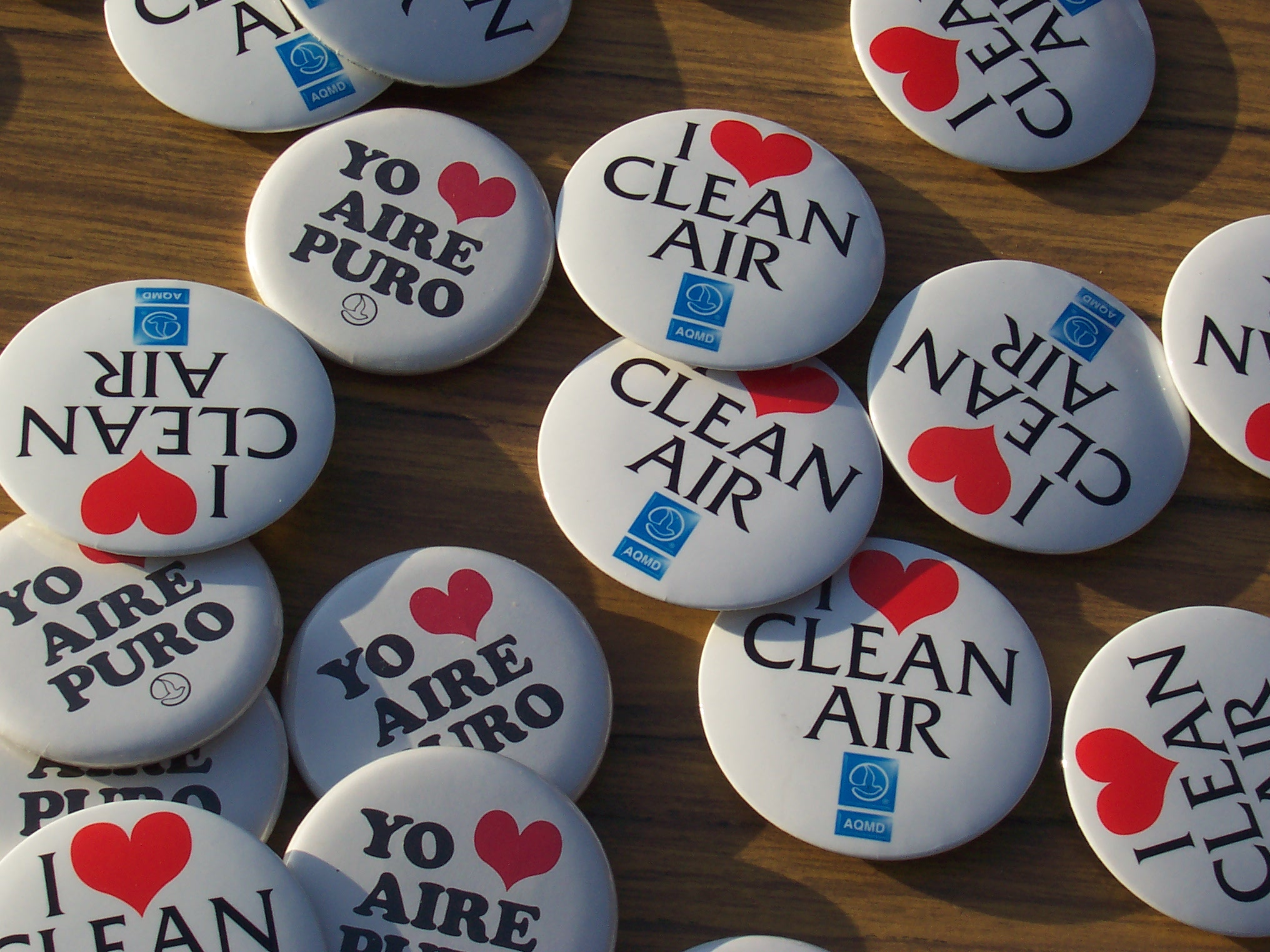 "Assortment of pins that say ""I love clean air."""