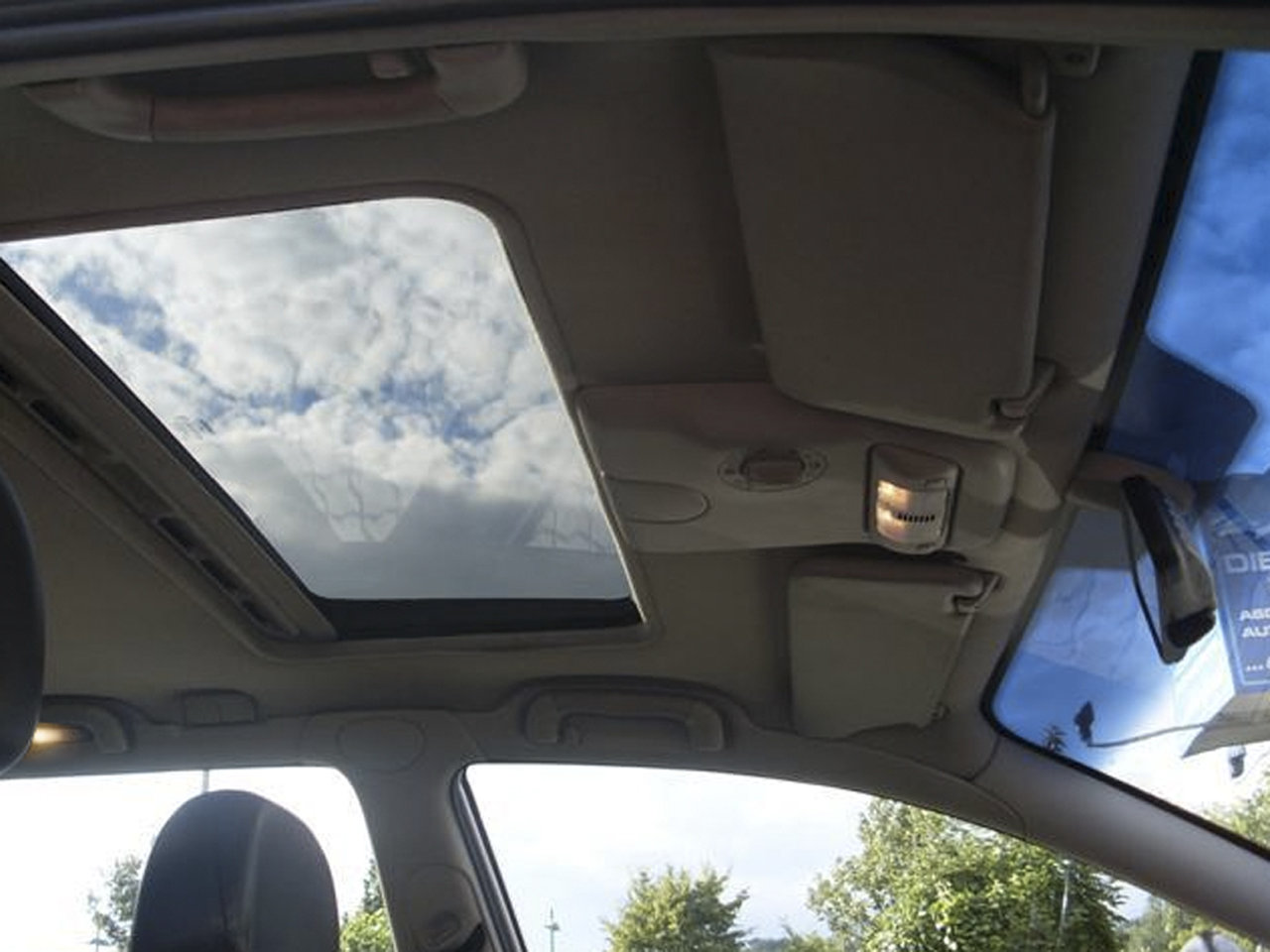 Aftermarket electric sunroof