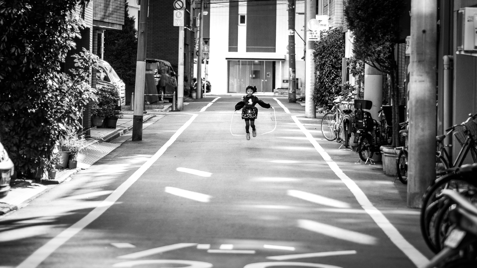 Filehappiness tokyo japan black and white street photography 241077215 jpeg