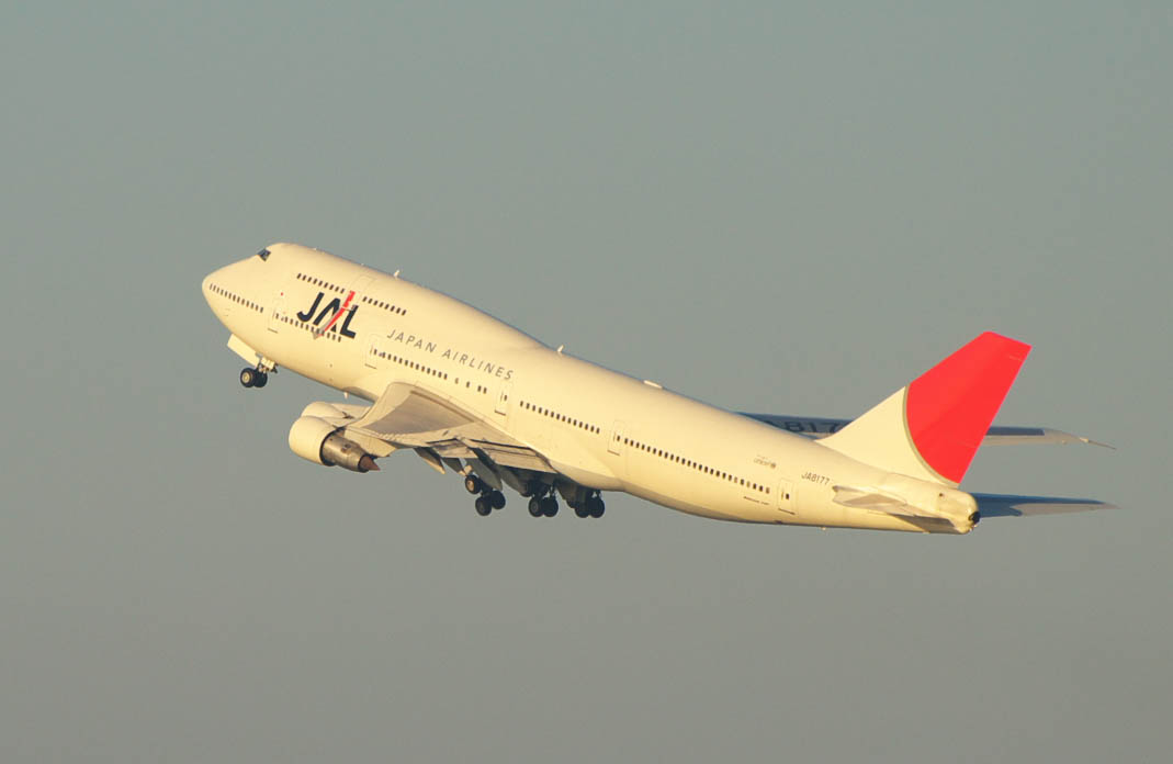 A Boeing 747–300 aircraft in mid air during take-off, with grey sky in the background