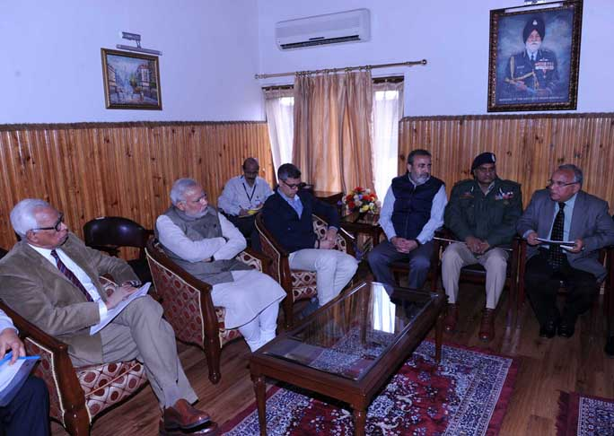 Prime Minister Modi at a meeting in Jammu and Kashmir to assess flood situation