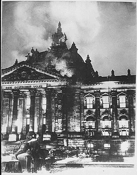 Firemen work on the burning Reichstag Building, February, 1933