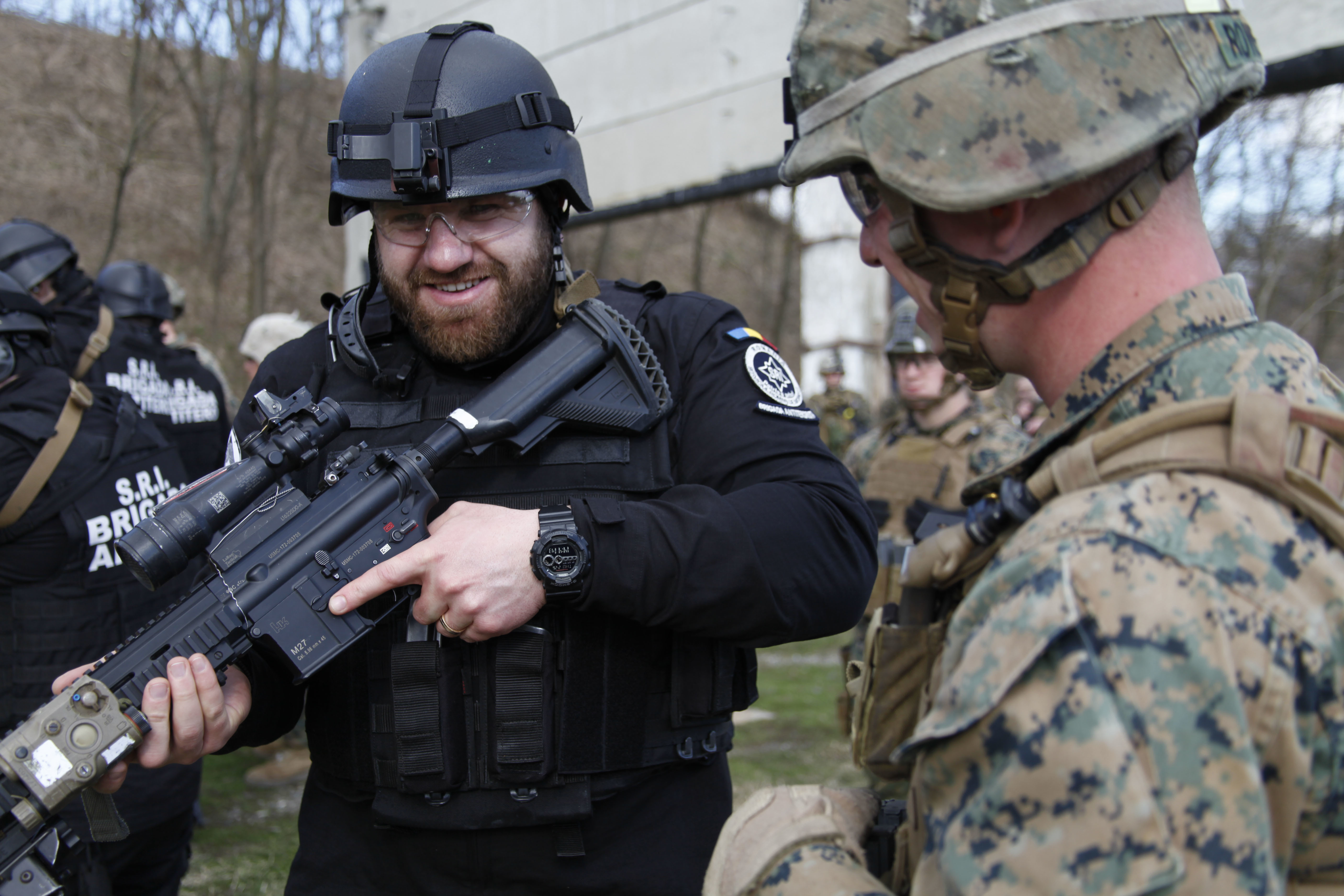 filesecurity force marines and marine security guards conduct weapons training with the romanian sri