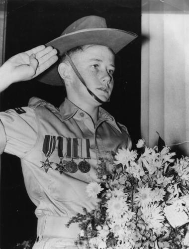 File:Soldier's son wearing his father's medals on Anzac Day, Brisbane, 1954 (4536575731).jpg