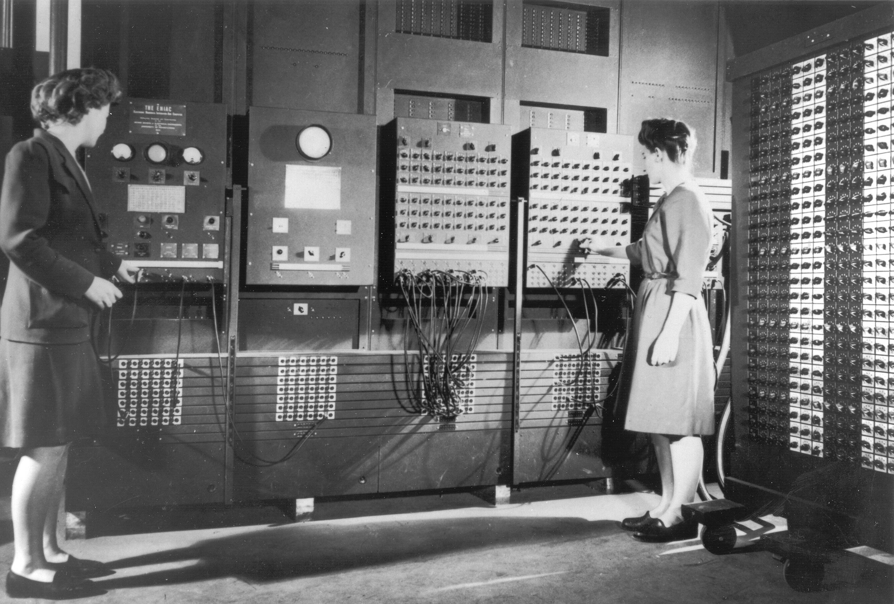 Two of the ENIAC programmers operating the computer, important women in programming