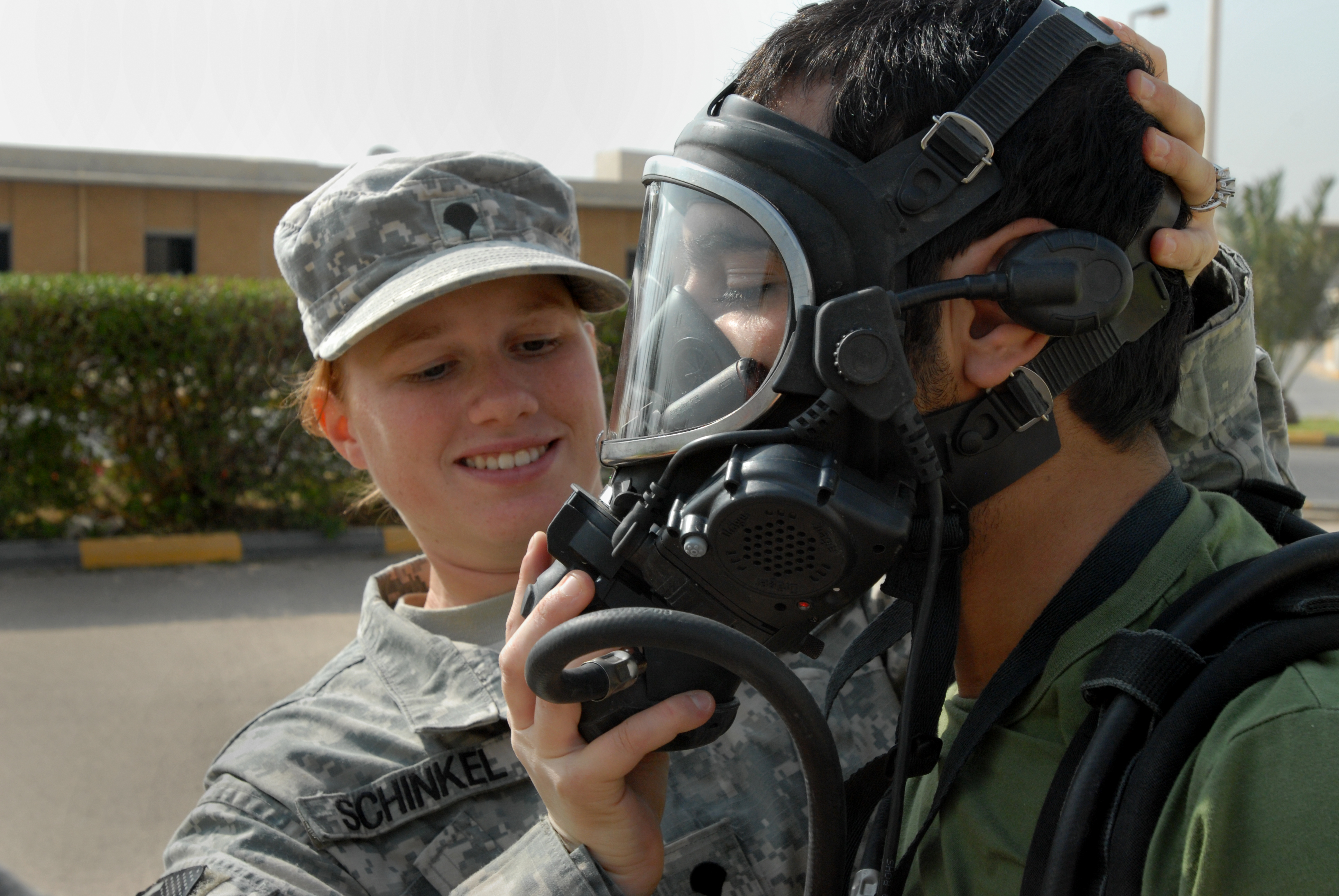 U.S._Army_Spc._Amanda_K._Schinkel%2C_a_chemical_operations_specialist_assigned_to_the_Reconnaissance_Platoon%2C_61st_Chemical_Company%2C_115th_Fires_Brigade%2C_attaches_an_oxygen_hose_to_the_protective_mask_of_a_Kuwait_091118-A-PT935-510