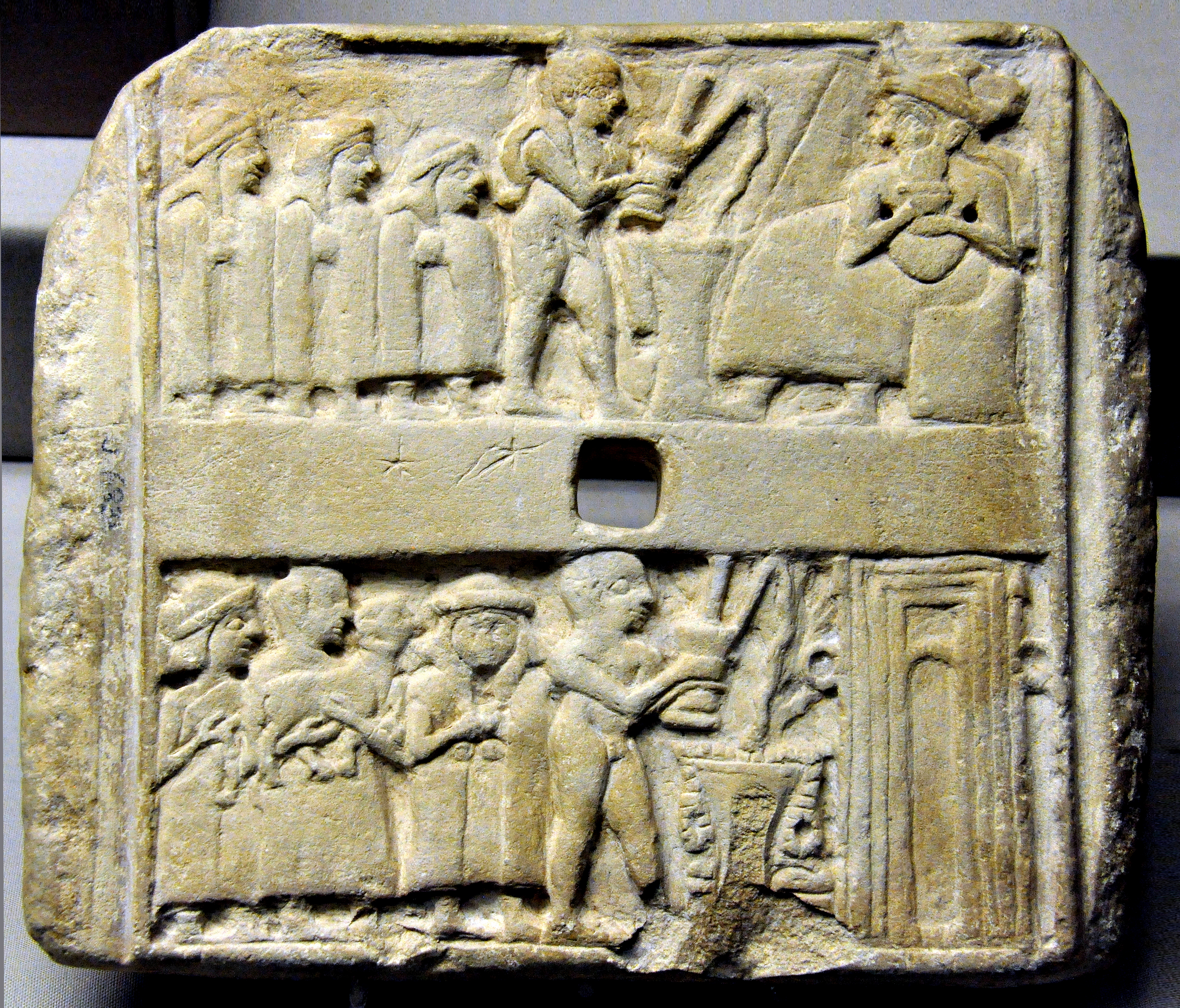 early tablet showing a religious meeting replete with ale