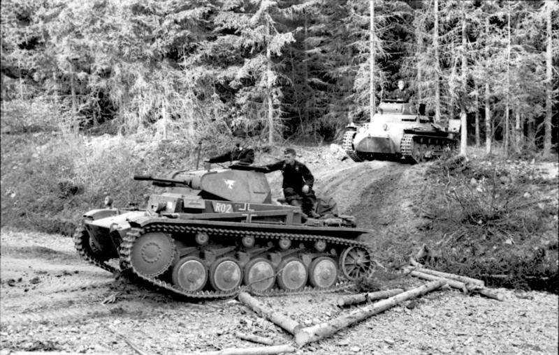 Light Panzers crossing the forested terrain of the Ardennes