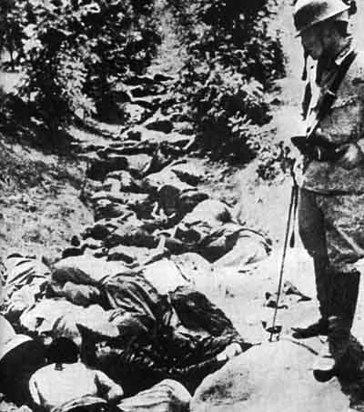 Soochow, China, 1938. A ditch full of the bodies of Chinese civilians killed by Japanese soldiers. Chinese killed by Japanese Army in a ditch, Hsuchow.jpg
