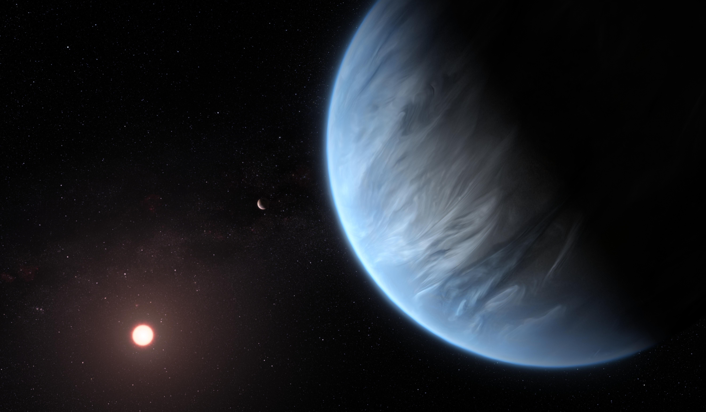 Artystyczna wizja egzoplanety K2-18b i jej gwiazdy macierzystej, czerwonego karła K2-18. Źródło: ESA/Hubble