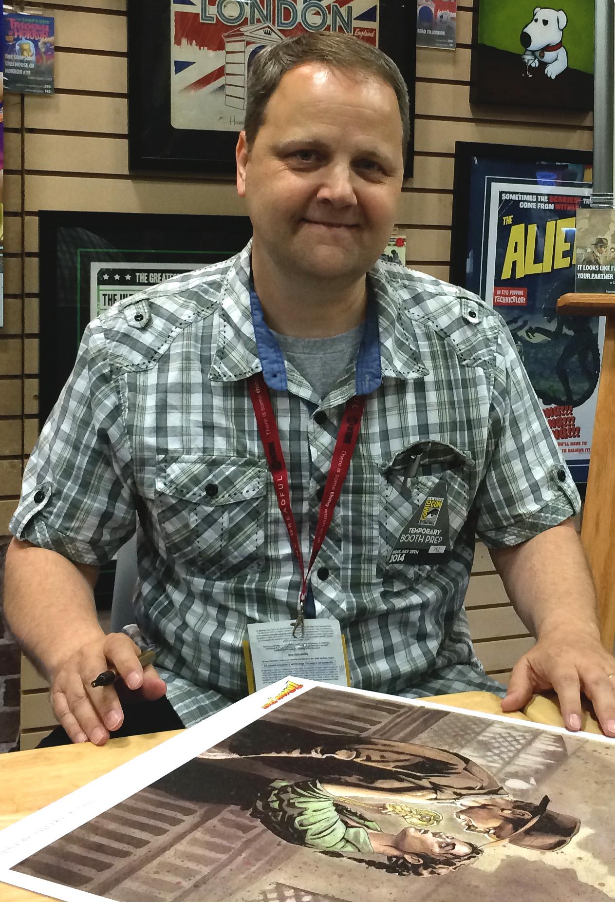 Gary Shipman signs his [[Indiana Jones (franchise)|Indiana Jones]] artwork at [[San Diego Comic-Con]] in 2014.