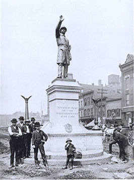 Workers finish installing Gelert's statue of a Chicago policeman in Haymarket Square, 1889. The statue now stands at the Chicago Police Headquarters. - Haymarket affair