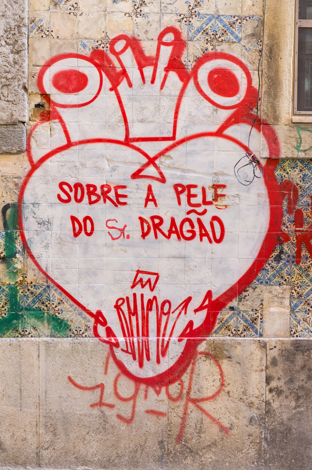 graffiti of a red heart with veins emerging; inside are the words