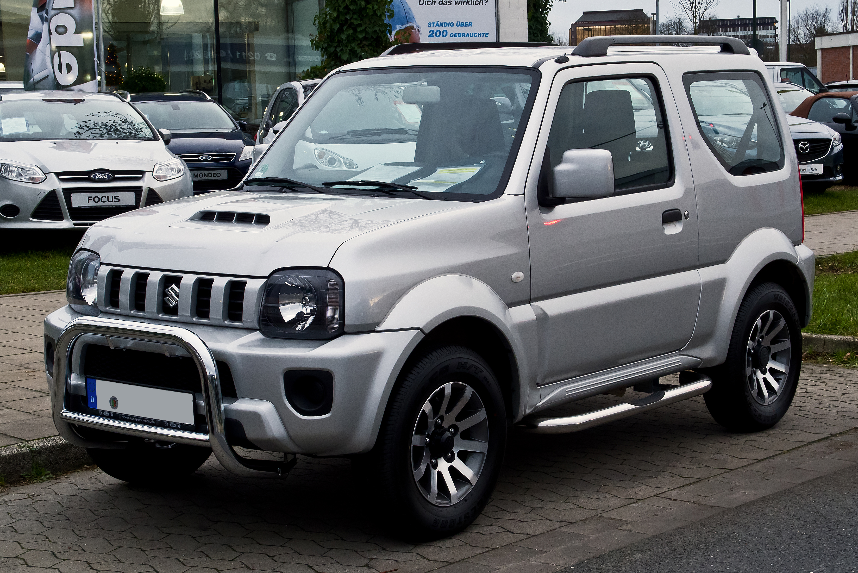 file suzuki jimny 1 3 club 2 facelift frontansicht 21 dezember 2013 d. Black Bedroom Furniture Sets. Home Design Ideas