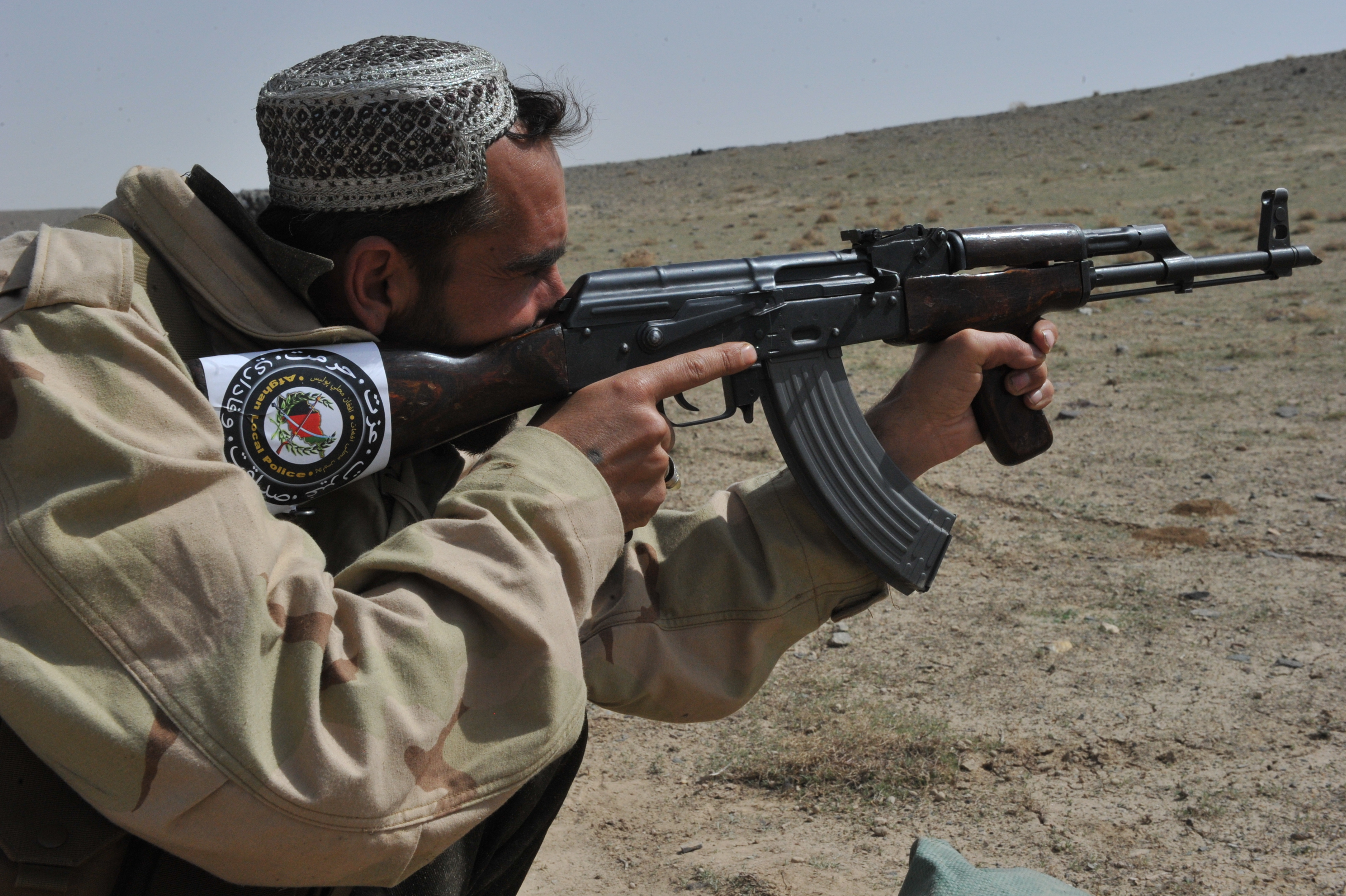 Pics photos police background police background police background - File An Afghan Local Police Recruit Fires An Ak 47 Rifle