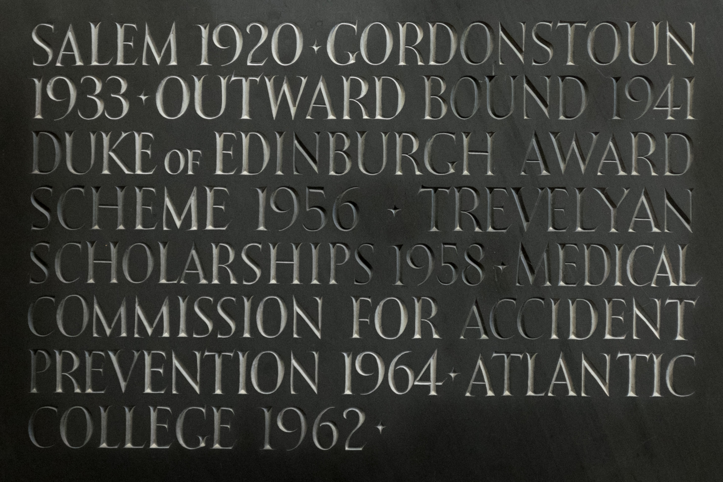 """Initiatives Kurt Hahn was """"decisive in founding,"""" listed on a commemorative plaque at Atlantic College, Wales."""