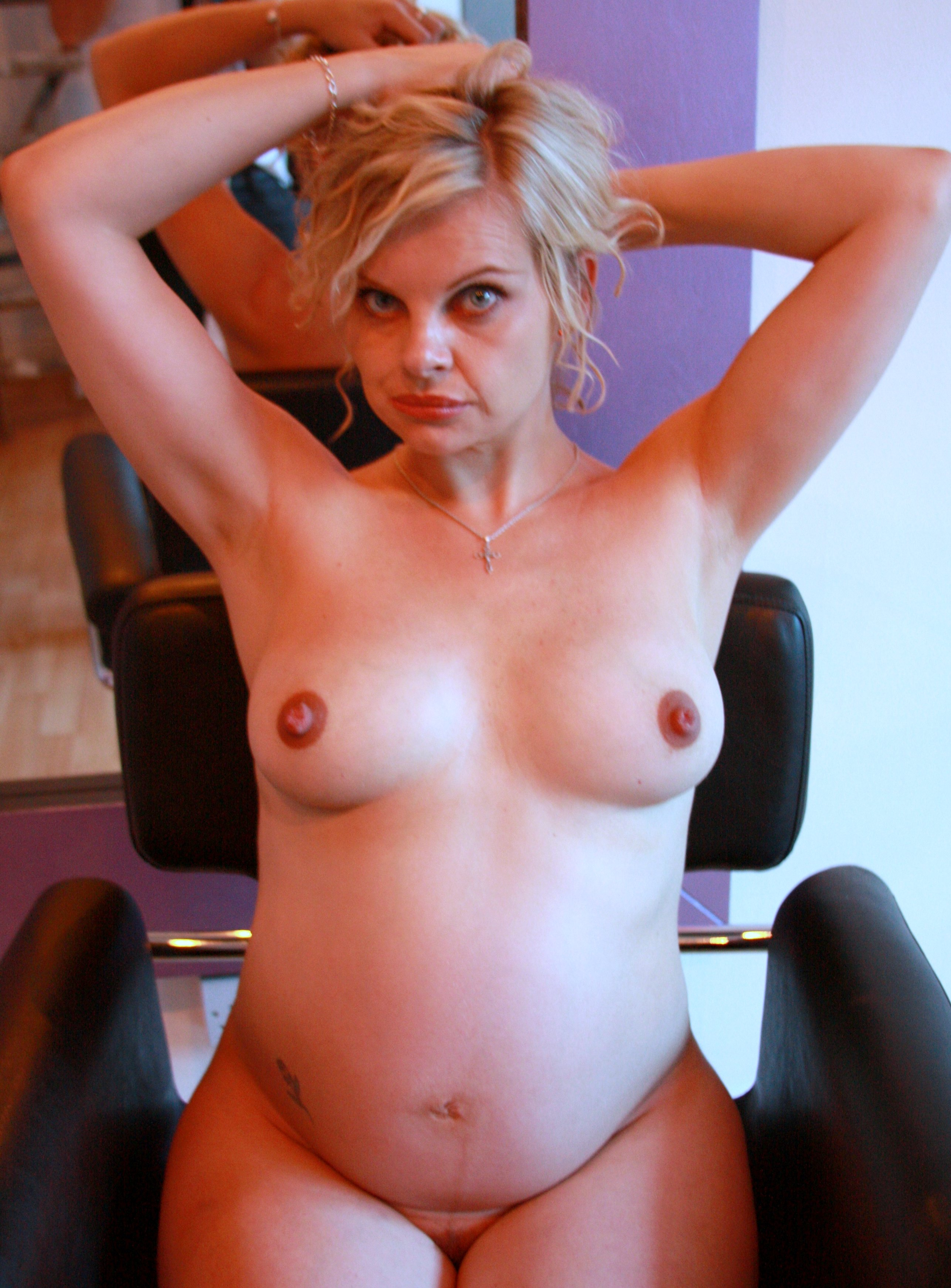 File:Nude pregnant woman on hairdresser's chair color.jpg