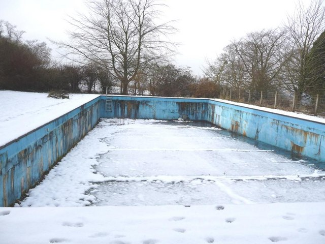 File snow covers the empty swimming pool for Unused swimming pool